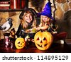 Witch  children with pumpkin lantern. Halloween. - stock photo