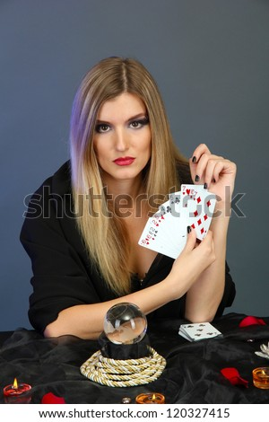 Witch - fortune teller on color background - stock photo