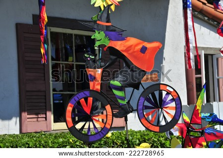 WITCH ON A BICYCLE, SAN DIEGO CALIFORNIA - SEPTEMBER 22, 2014: WITCH ON BICYCLE FOR SALE IN A SHOP FOR HALLOWEEN - stock photo