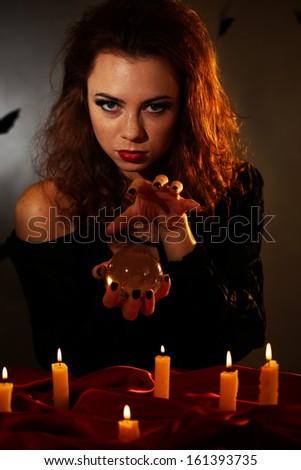 Witch on dark background - stock photo