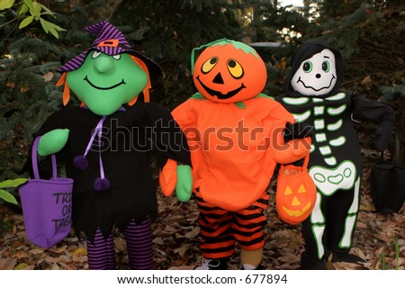 Witch, Pumpkin and Skeleton friends decoration. - stock photo