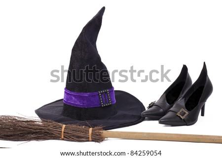 Witch's costume, hat, shoes and broomstick, white background, - stock photo