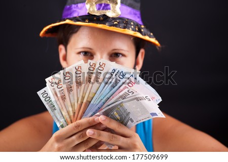 witch show money in studio - stock photo