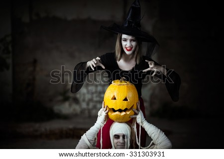 Witch using spells to invoke the Halloween spirits - stock photo