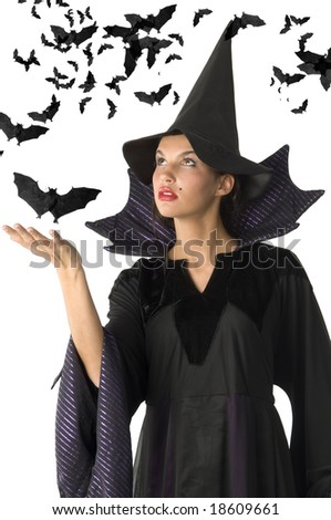 witch with black dress and hat having black bat all around