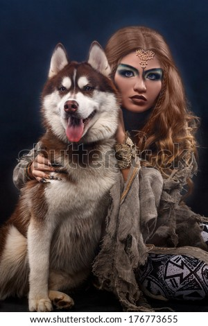 witch with the husky dog - stock photo