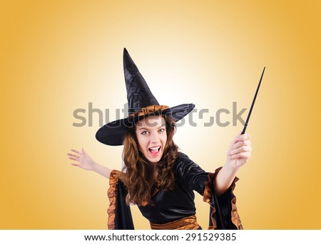 Witch with wand against the gradient  - stock photo