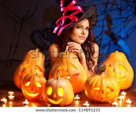 Witch woman with group Jack O'Lantern.