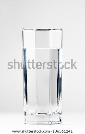 With a glass of water on a white background - stock photo