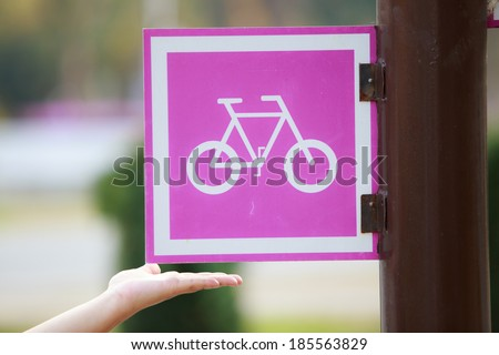 With bicycle sign To reduce global warming - stock photo