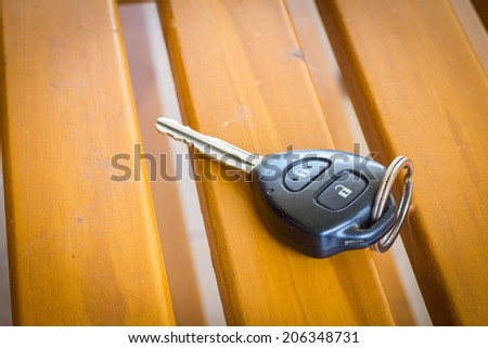 With car keys on the table. - stock photo