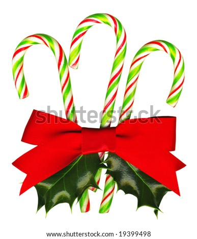 With Clipping Path, ready to use. Three candy canes tied with a red ribbon and with a holly sprig.