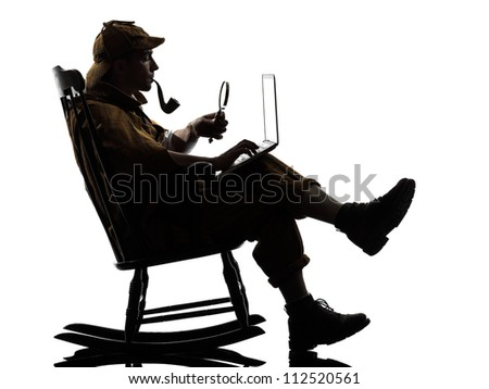 With computer laptop silhouette sitting in rocking chair in studio on white background - stock photo