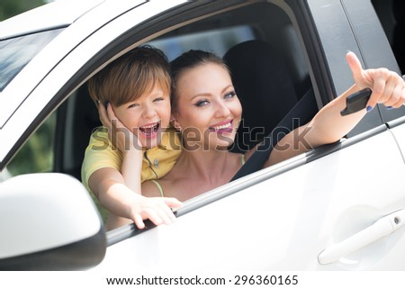 with her son in the car - stock photo