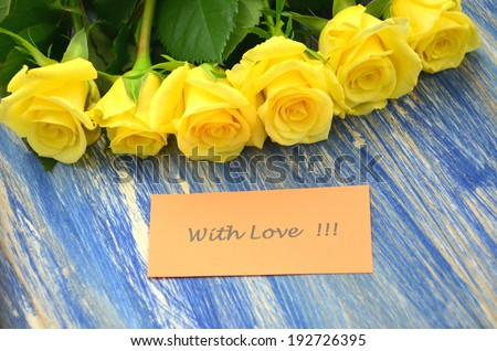 with love wishes and bouquet of gorgeous roses - stock photo