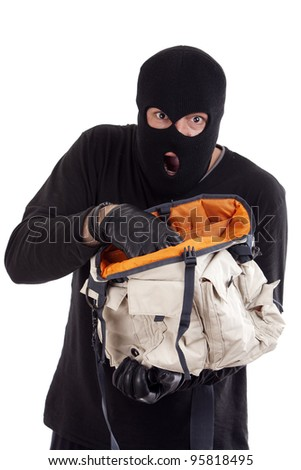 with mask thief who has stolen a bag - stock photo