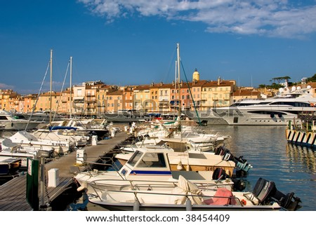 With old builnd and luxury yachts nearby - stock photo