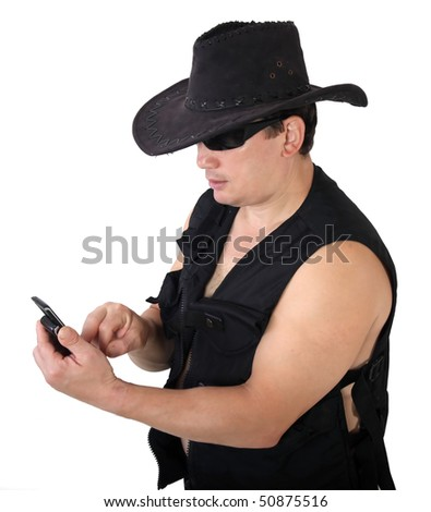 with phone in black capcowboy - stock photo