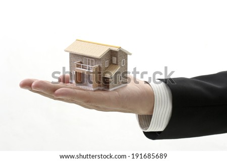 With the sale authorized, a model of the house, businessman - stock photo