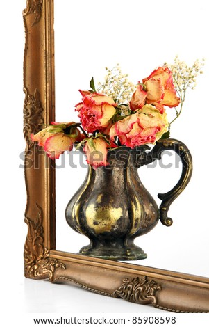 Withered flowers. flower in the bronze vase. It should be framed in the frame isolated on a white background.