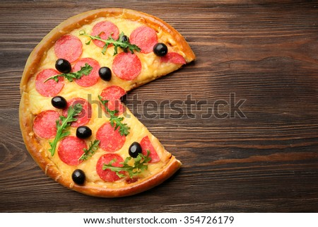 Without-one-piece tasty pizza  on wooden background, close up