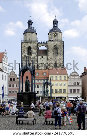 Wittenberg, Saxony-Anhalz, Germany - April 28, 2007: Market place of Wittenberg with the church Saint Marien and the memorials for Martin Luther and Philipp Melanchthon.