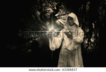 Wizard gazing into a crystal ball - stock photo