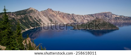 Wizard Island is a volcanic cinder cone which forms an island at the west end of Crater Lake - stock photo