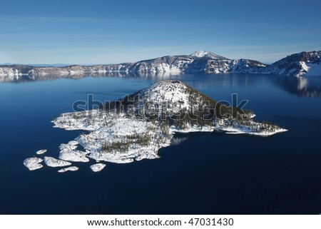 Wizard Island Winter at Crater Lake Oregon, sunny day. - stock photo