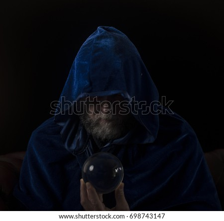 wizard crystal ball blue hooded cloak stock photo 698743147