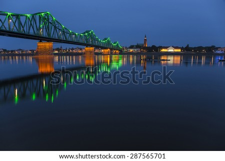 Wloclawek at night with river reflections