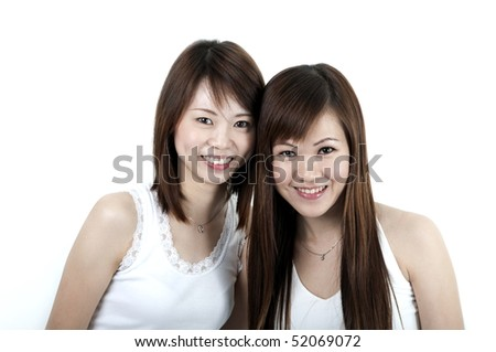 wo cheerful Asian girls isolated on white background. - stock photo
