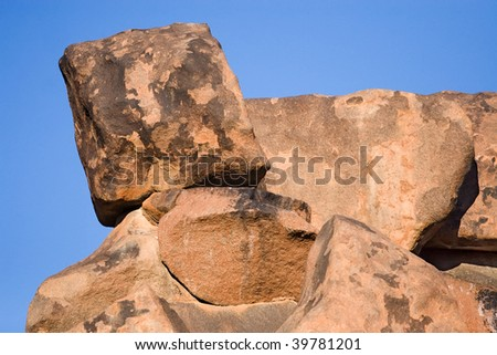 wobbly boulder almost tipping over - stock photo