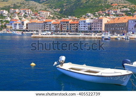 Woden boat on the Adriatic sea inside the harbor of Senj, Croatia - stock photo