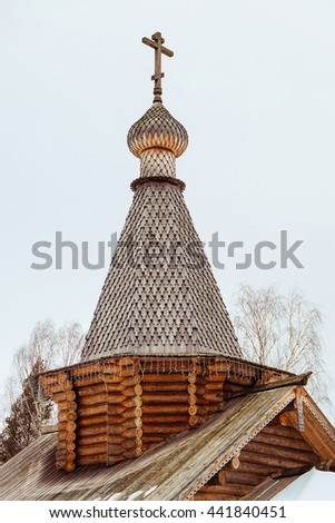 Woden dome of Russian Orthodox church. Wooden church. Church with wooden cross and dome. - stock photo