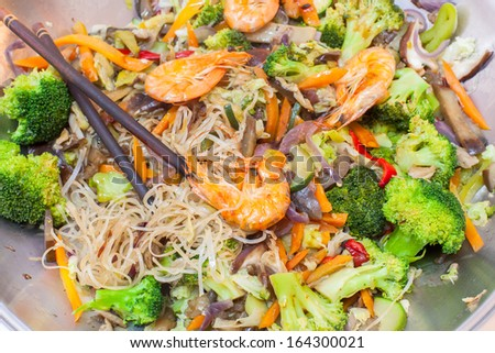 Wok cooked dish with shrimps and vegetables - stock photo