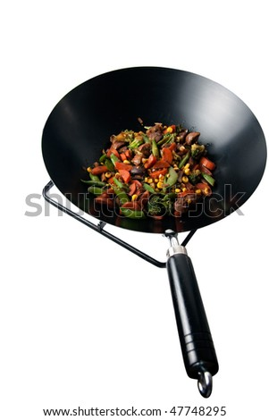 wok full of fresh colorful vegetables ready to eat