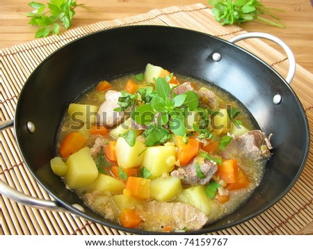 Wok goulash with vegetables and herbs - stock photo