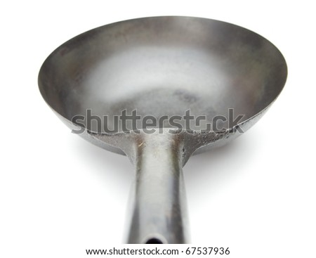 Wok, seen from the chef, in real world condition, isolated on white. Authentic hand forged asian wok.