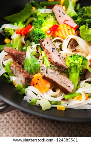 wok stir fry with beef and vegetable selective focus - stock photo