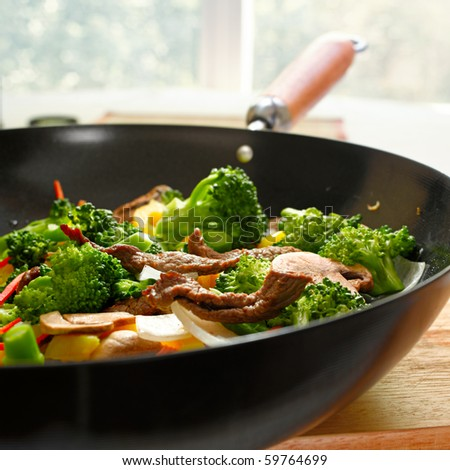 wok stir full of stir fry - stock photo
