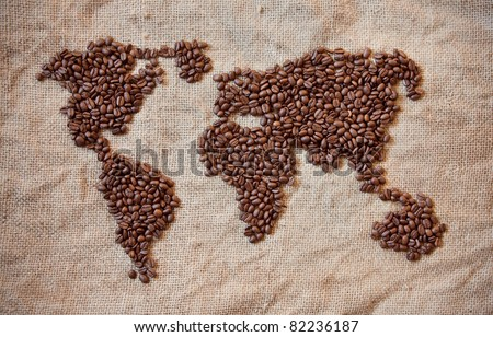 wold map made of coffee beans on textured background - stock photo