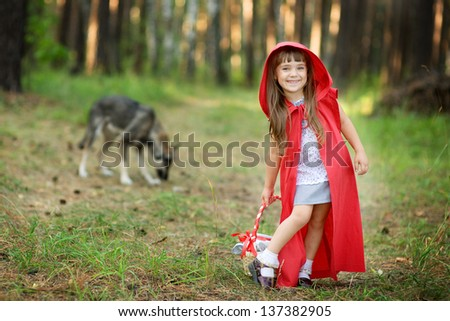 "wolf pursues the girl. the fairy tale "" Red Riding Hood"""