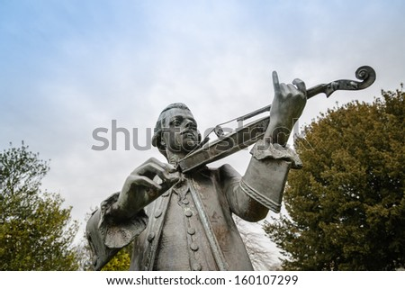 Wolfgang Amadeus Mozart statue in Parade Gardens, Bath Spa, Somerset. - stock photo
