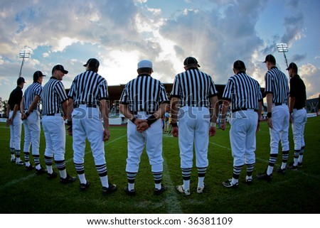 WOLFSBERG, AUSTRIA - AUGUST 18 American Football B-EC: The referees prepare for the game Italy vs. Austria on August 18, 2009 in Wolfsberg, Austria. - stock photo