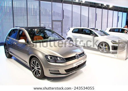 WOLFSBURG, GERMANY - AUGUST 14, 2014: Brand new compact cars Volkswagen Golf in the trade center of the Volkswagen Autostadt. - stock photo