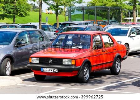 WOLFSBURG, GERMANY - AUGUST 14, 2014: Red motor car Volkswagen Jetta in the city street. - stock photo