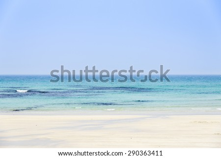 Woljeongri beach in Jeju Island, Korea. Woljeong beach is famous for white sand and beautiful scenery. And there are many beautiful cafes along the Woljeongri coast road. - stock photo