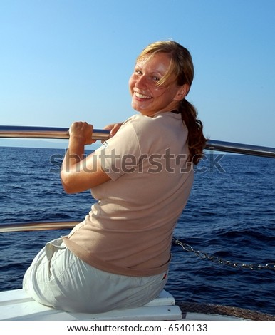 woman A white speedboat in the Caribbean. - stock photo