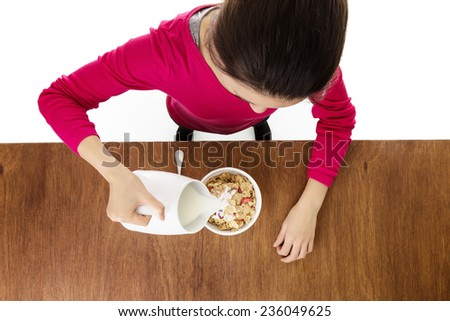 woman about to eat her cereal taken from a birds eye view looking down - stock photo